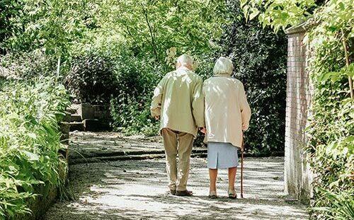 Two elderly people walking